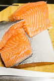 Fresh raw salmon on wooden. Piece of fresh raw salmon on wooden Stock Photography