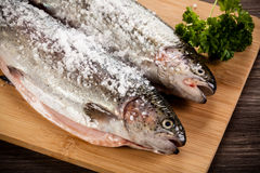 Fresh raw salmon. On wooden board Royalty Free Stock Photo