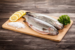Fresh raw salmon. On wooden board Stock Photography