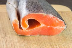 Fresh Raw Salmon on wooden Board. Fresh Raw Salmon on wooden  bamboo Board Royalty Free Stock Images