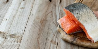 Fresh raw salmon. On a wooden cutting board Royalty Free Stock Image