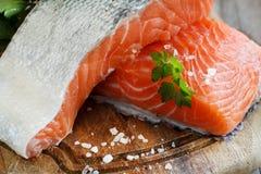 Fresh raw salmon. On a wooden cutting board Stock Photo