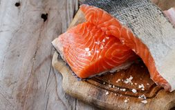 Fresh raw salmon. On a wooden cutting board Stock Photos