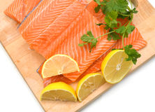 Fresh raw salmon. On wooden cutting board Royalty Free Stock Image