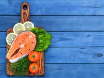 Fresh raw salmon on wooden cutting board. Stock Images