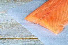 Fresh raw salmon on wooden cutting board. Raw salmon fillet Stock Photo