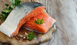 Fresh raw salmon. On a wooden cutting board Royalty Free Stock Images