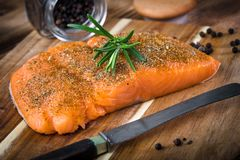 Fresh raw salmon. Fresh raw salmon on wooden cutting board Stock Images