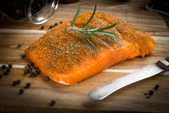 Fresh raw salmon. Fresh raw salmon on wooden cutting board Royalty Free Stock Image