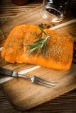 Fresh raw salmon. Fresh raw salmon on wooden cutting board Stock Photo