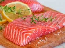 Fresh raw salmon on wooden cutting board Royalty Free Stock Photo