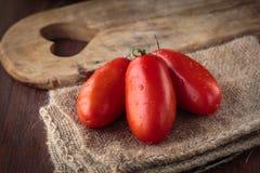 Fresh raw San Marzano tomatoes Stock Photos