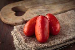 Fresh raw San Marzano tomatoes. Delicious fresh raw San Marzano tomatoes for an healthy meal Royalty Free Stock Photos