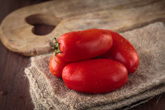 Fresh raw San Marzano tomatoes. Delicious fresh raw San Marzano tomatoes for an healthy meal Stock Photography