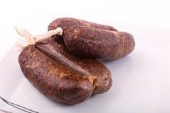 Raw sausage. Fresh raw sausage on dish Royalty Free Stock Photography