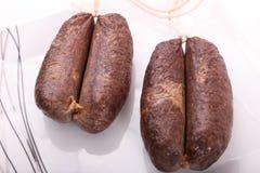 Raw sausage. Fresh raw sausage on dish Stock Photography