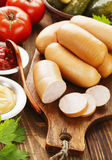 Fresh raw sausage. Fresh meat sausage on the wooden table Stock Photos