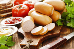 Fresh raw sausage. Fresh meat sausage on the wooden table Stock Photo