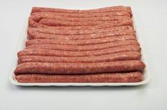 Fresh raw sausage. On white background Royalty Free Stock Image