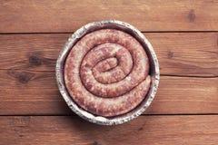 Fresh raw sausage Stock Photos