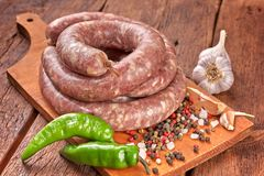 Fresh raw sausage. Ingredient, charcuterie. Fresh raw sausage on the wooden background stock photos