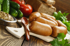 Fresh raw sausage. On the wooden table Royalty Free Stock Images