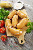 Fresh raw sausage. On the wooden table Royalty Free Stock Photos