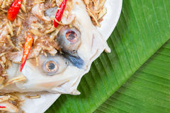 Fresh raw sea bass with chili on plate. And banana leaf in background Stock Image
