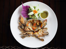 Fresh raw sea crab served with spicy Thai style seafood sauce. Royalty Free Stock Images