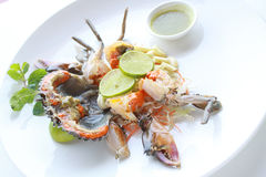 Fresh raw sea crab served with spicy Thai style seafood sauce. Royalty Free Stock Image