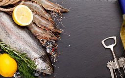 Fresh raw sea food with spices and white wine bottle Royalty Free Stock Images