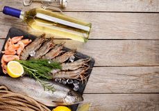 Fresh raw sea food with spices and white wine bottle Royalty Free Stock Photo