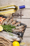 Fresh raw sea food with spices and white wine. On wooden table background. Top view Royalty Free Stock Photos
