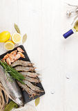 Fresh raw sea food with spices and white wine Royalty Free Stock Image