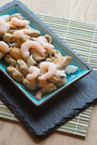 Fresh raw seafood mix of prawns mussels and squid on serving pla Royalty Free Stock Photo
