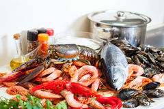Fresh raw seafoods and fish in  kitchen Royalty Free Stock Photos