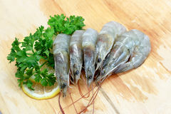 Fresh Raw Shrimp. On Chopping Board Royalty Free Stock Photos