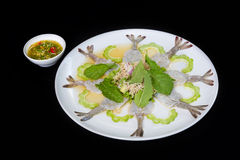 Fresh raw shrimp and herbs with seafood sauce. On black background Royalty Free Stock Photography