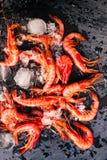 Fresh raw shrimps on a black board cose. Fresh raw shrimps on a black board Stock Photo