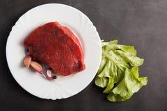 Fresh raw slice meat. Isolated on white background Stock Image