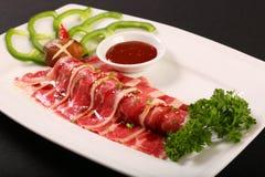 Fresh raw sliced beef on white dish Royalty Free Stock Photos
