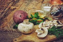 Fresh raw sliced mushrooms with herbs and potatoes Royalty Free Stock Images