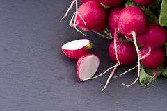 Fresh raw spicy radish. On slate background Royalty Free Stock Photos