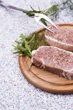 Fresh Raw Steak Meat with spaces, herbs and vegetables. Fresh Raw Steak Meat with spaces, herbs on wooden board royalty free stock image