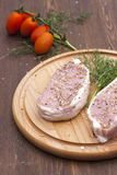 Fresh Raw Steak Meat with spaces, herbs and vegetables on wooden board Stock Photo