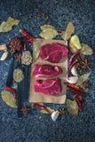 Fresh raw steak on the slate.  Stock Photo