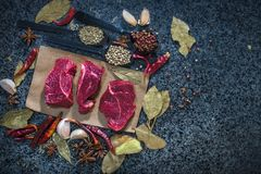 Fresh raw steak on the slate.  Royalty Free Stock Images
