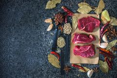 Fresh raw steak on the slate.  Royalty Free Stock Image