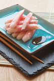 Fresh raw sushi crabsticks on plate with chopsticks Stock Image
