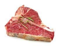 Fresh raw T bone steak. Isolated on white background Stock Photos